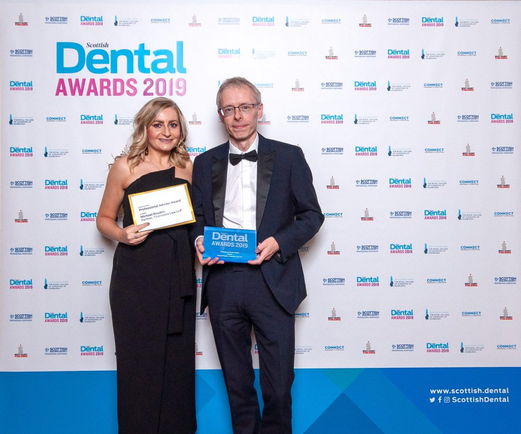 Micheal, with award presenter Jennifer Glenn from Dentsply Sirona